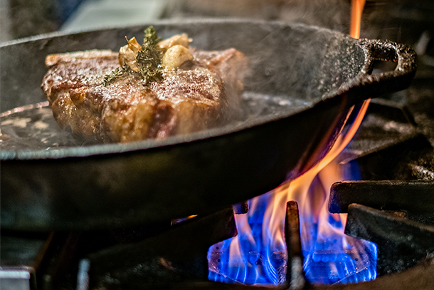 A Creekstone Farms steak seared in a ripping hot cast iron skillet at Resto in New York [Photo: Nick Solares/Serious Eats]